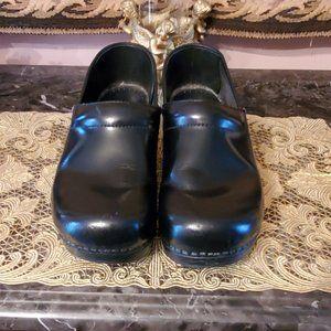 Dansko Black Leather Slip On Closed Back Clogs